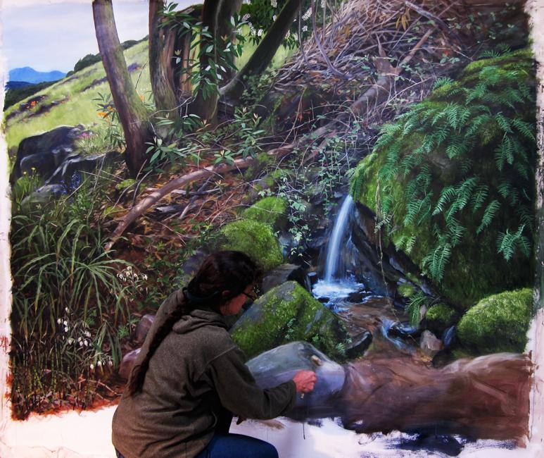 Ali Pearson working on the seasonal spring waterfall mural