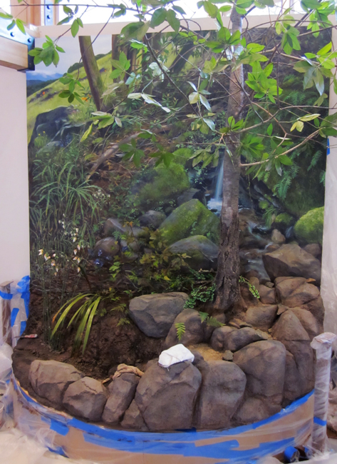 The seasonal-spring waterfall mural is it is being integrated into the site